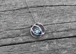 Negative space sapphire pendant